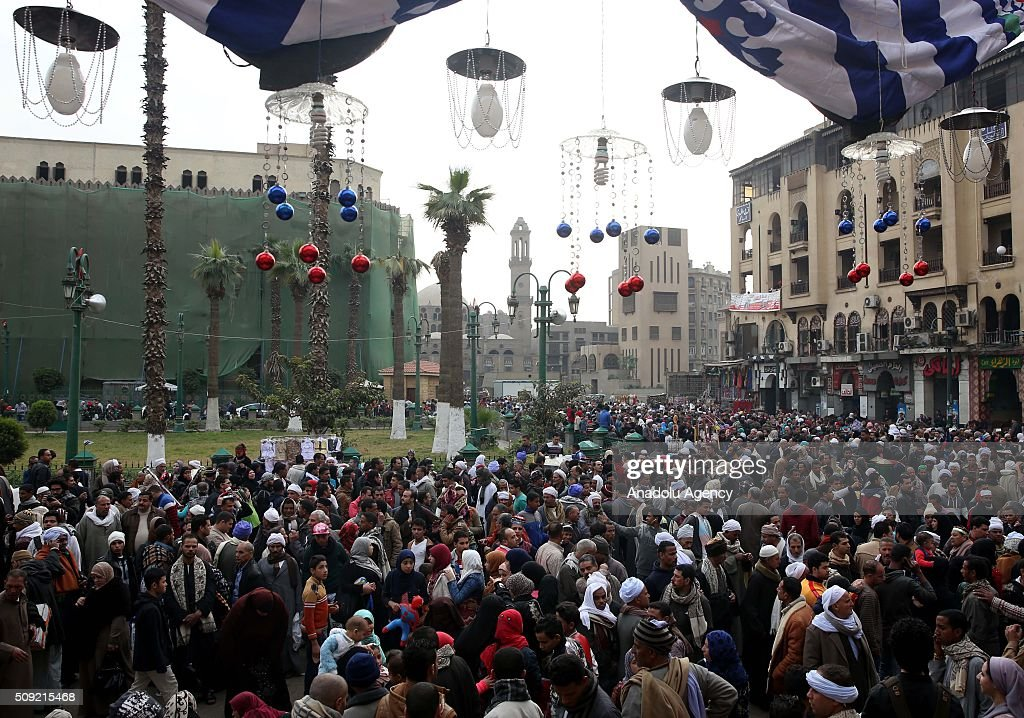 Egyptians are seen outside the al-Hussein mosque as they prepare to celebrate Mawlid Al Hussein, a Sufi gathering which commemorates the birth of the Muslim Prophet Muhammad's grandson, in Cairo, Egypt on February 9, 2016. The celebration attracts thousands of Muslims from all over the country to the mosque and shrine named for him.