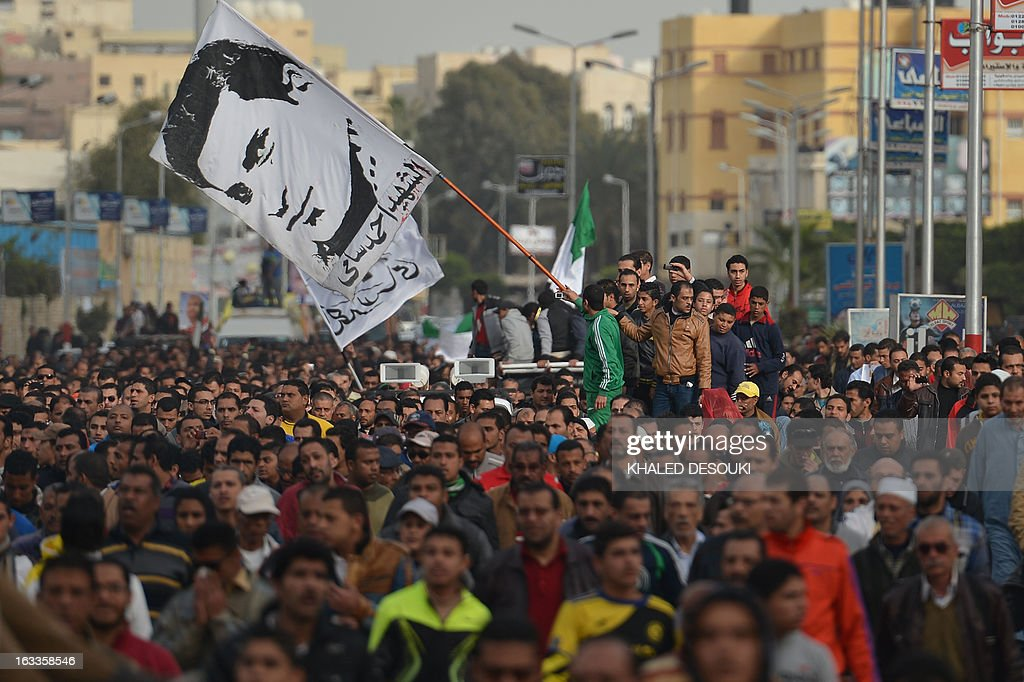 Egyptians attend the funeral procession of Abdelhalim Mehana, who was killed during clashes with riot police on March 4, during his funeral in the Suez Canal city of Port Said on March 8, 2013, a day before a court is to issue verdicts over the killing of people in a football riot there. AFP PHOTO / KHALED DESOUKI