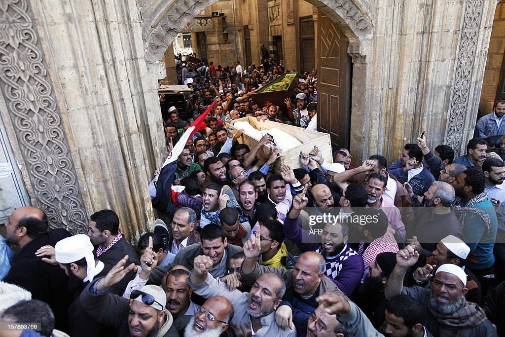 Egyptians carry the body of a supporter of President Mohamed Morsi during a funeral in Cairo, on December 7, 2012. Seven people died in clashes between Morsi's Islamist supporters and his mainly secular opponents on in Egypt's worst political crisis since Morsi took office in June.