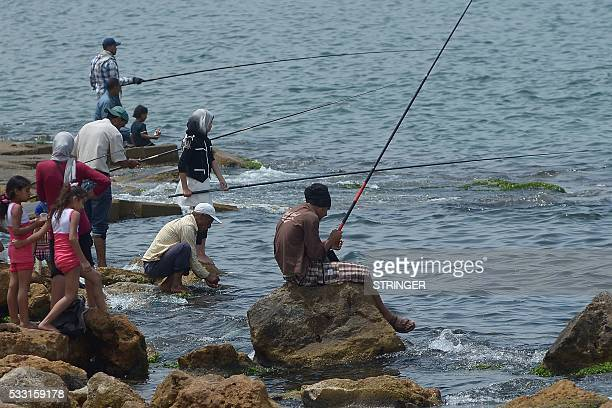 Egyptians fish on the seaside on May 21 2016 in the coastal Egyptian city of Alexandria / AFP / STRINGER