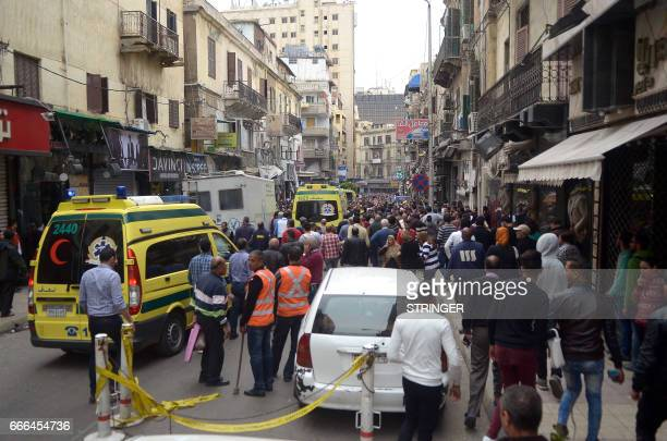 Egyptians gather at near a church in Alexandria after a bomb blast struck worshippers gathering to celebrate Palm Sunday on April 9 2017 The Interior...