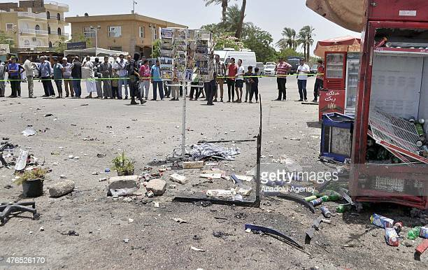 Egyptians gather at the site of a suicide car bomb attack near the ancient Karnak Temple in Egypts southern city of Luxor on June 10 2015