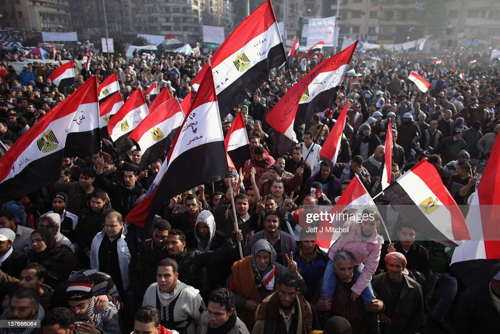 Egyptians gather in Tahrir Square to mark the one year anniversary of the revolution on January 25 2012 in Cairo Egypt Tens of thousands are...