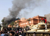Egyptians gather next to an army Republican Guard tank in Cairo's Tahrir Square on January 29 2011 as they help protecting Cairo's museum from...