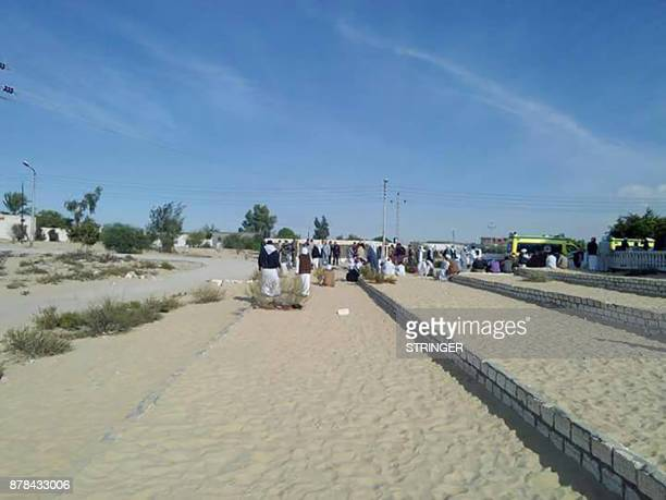 Egyptians gather outside the Rawda mosque roughly 40 kilometres west of the North Sinai capital of ElArish following a gun and bombing attack on...