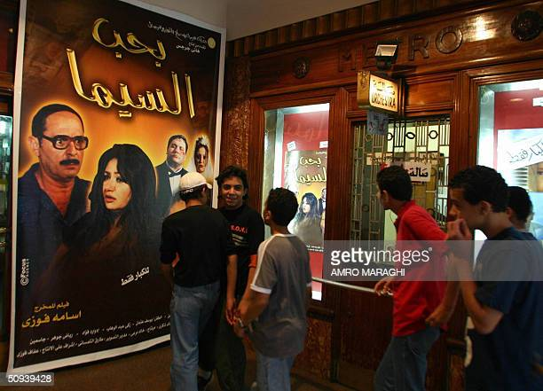 Egyptians look at posters of a film about the Coptic Christians of Egypt which is to open in theatres across the country after tomorrow at a cinema...