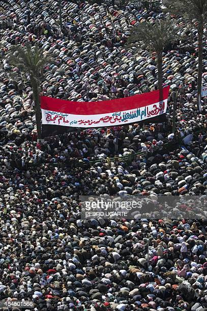 Egyptians pray at Cairo's Tahrir Square on February 18 2011 during celebrations marking one week after Egypt's longtime president Hosni Mubarak was...