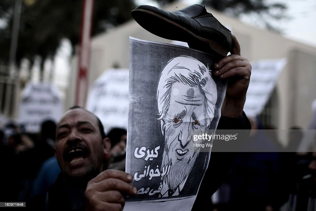 Egyptians protest against Egyptian President Mohamed Morsi and U.S. Secretary of State John Kerry during a march to the foreign ministry on March 2, 2013 in Cairo, Egypt. The new U.S. Secretary of State is on his first trip, visiting nine nations in Europe and the Middle East.