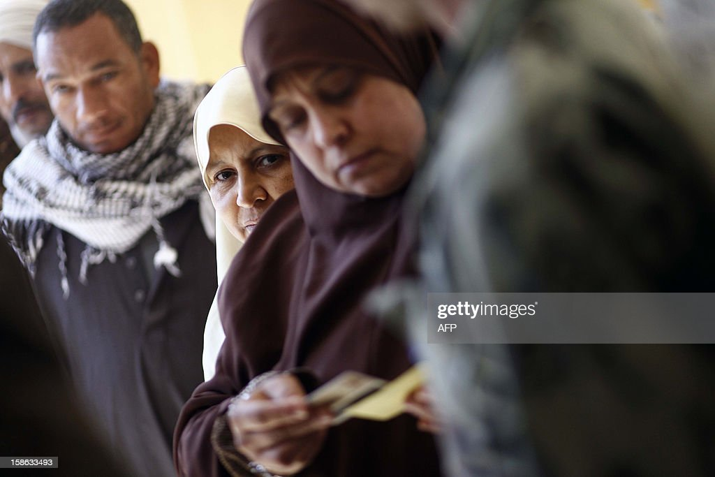 Egyptians queue at a polling station during the second round of a referendum on a new draft constitution in Beni Sueif, south of Cairo, on December 22, 2012. Egyptians are voting in the final round of a referendum on a new constitution championed by President Mohamed Morsi and his Islamist allies against fierce protests from the secular-leaning opposition.