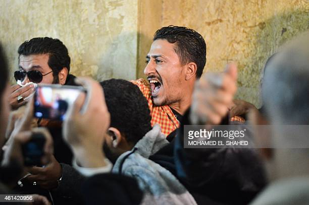 Egyptians react at a court in Cairo following the acquittal on January 12 2015 of 26 male defendants accused of 'debauchery' after they were arrested...