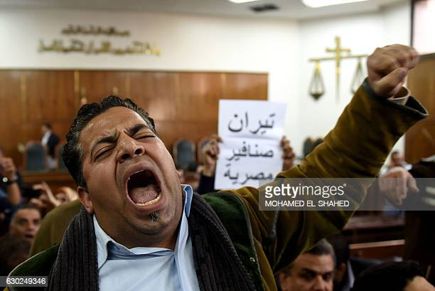 Egyptians react on December 19 2016 at the high administrative court as a judge announces the postponing of a court ruling in the case of two Red Sea...