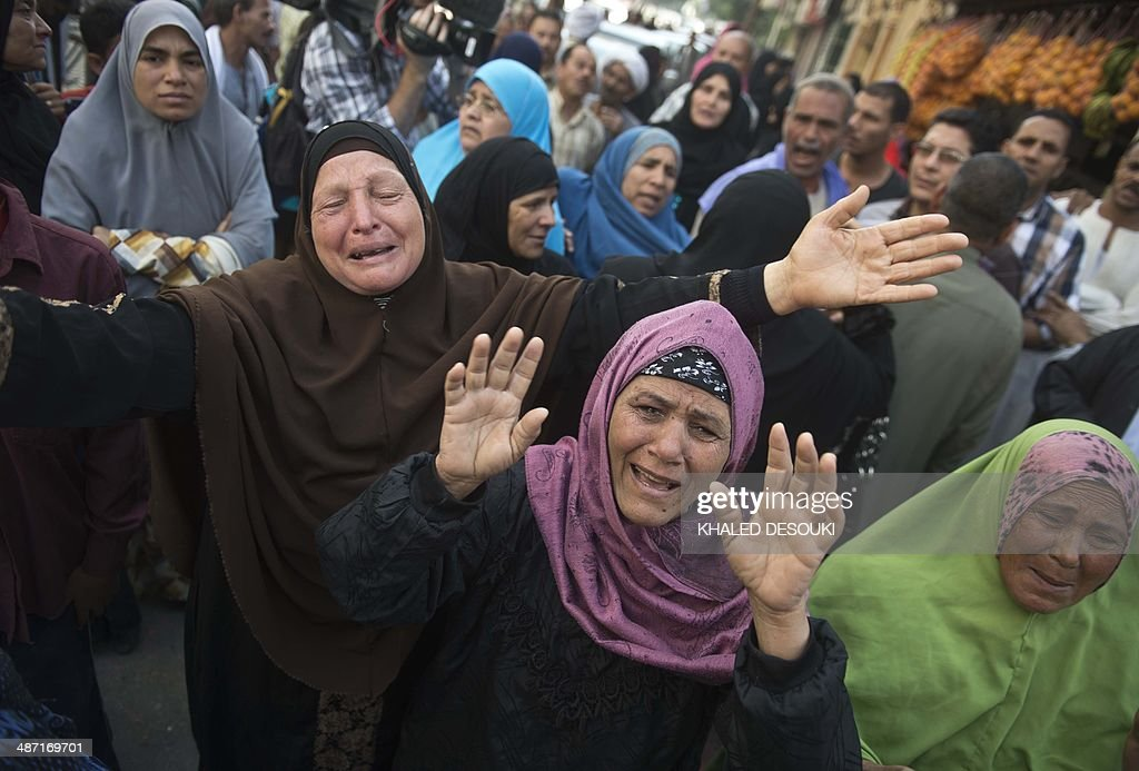 Egyptians react outside the courtroom in Egypt's southern province of Minya after an Egyptian court sentenced Muslim Brotherhood leader Mohamed Badie and other alleged Islamists to death on April 28, 2014. The defendants were accused of involvement in the murder and attempted murder of policemen in Minya province on August 14, the day police killed hundreds of ousted Islamist president Mohamed Morsi's supporters in clashes in Cairo.