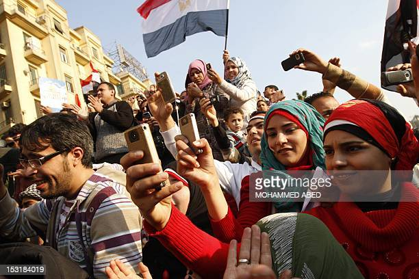 Egyptians use their mobile phone to record celebrations in Cairo's Tahrir Square the epicentre of the popular revolt that drove veteran strongman...