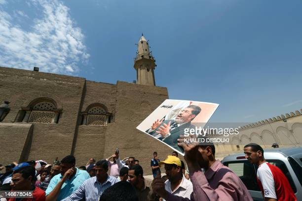 Egyptians wait to see Muslim Brotherhood presidential candidate Mohamed Morsi after he attended Friday noon prayers at the historical mosque of Amr...
