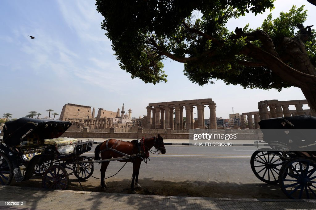 Egyptians wait with their horses and carriages for tourist outside Luxor temple, in the Egypt's ancient temple city on February 27, 2013, a day after a hot air balloon exploded and plunged to earth near the city during a sunrise flight, killing up to 19 tourists, including Asians and Europeans, sources said. An initial probe into the hot air balloon crash has ruled out any criminal activity as a cause of the accident, state media said.