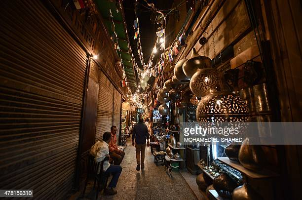 Egyptians walk at the Khan elKhalili market in Cairo during the Muslim holy fasting month of Ramadan on June 22 2015 AFP PHOTO / MOHAMED ELSHAHED