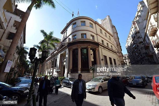 Egyptians walk in front of the Egyptian Stock Market in the capital Cairo on January 6 2013 A top International Monetary Fund official will visit...
