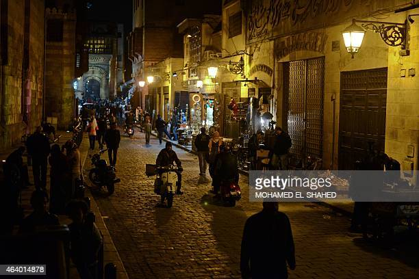 Egyptians walk on alMoez street in Cairos Khan alKhalili district on February 20 2015 AlMoez street is one of the oldest streets in Cairo...