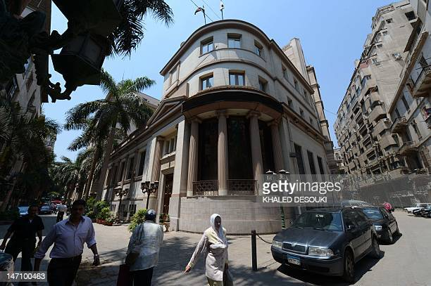Egyptians walk outside the stock exchange building in central Cairo on June 25 a day after Islamist Mohamed Morsi was elected the country's first...