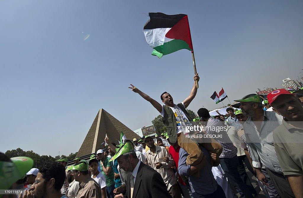 Egyptians wave the Palestinian flag during a rally to mark the the Naksa (setback) in Cairo on June 7, 2013. Egyptians mark 'Naksa Day' to mourn the 46th anniversary of Israel's occupation of the West Bank and Gaza Strip in the Six-Day War.