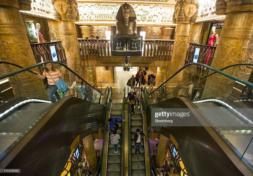 Egyptian-themed decor is seen as shoppers ride escalators inside Harrods luxury department store in London, U.K., on Monday, June 24, 2013. Harrods, which has more than 1 million square feet (90,000 square meters) of selling space, isn't concerned about the outlook for spending on luxury goods, Harrods Managing Director Michael Ward said. Photographer: Jason Alden/Bloomberg via Getty Images