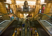 Egyptianthemed decor is seen as shoppers ride escalators inside Harrods luxury department store in London UK on Monday June 24 2013 Harrods which has...