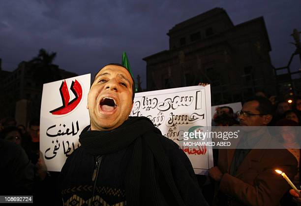 Egyption Muslims and Christians activists politicians and intellectuals demonstrate together in the Egyptian capital Cairo on January 7 to condemn...