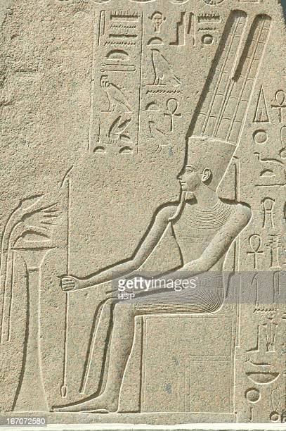 Egyptology Bas relief at the Egyptian Museum in Cairo depicting a pharaoh seated on his throne