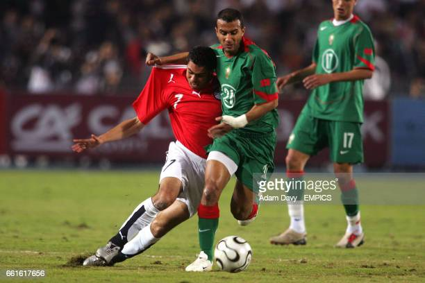 Egypt's Ahmed Abdel Fathi and Morocco's Badr El Kaddouri battle for the ball