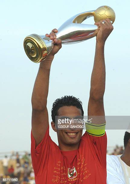 Egypt's AlAhly captain Shadi Mohamed holds the African Champions League trophy after drawing 22 with Cotonsport Garoua of Cameroon in the second leg...