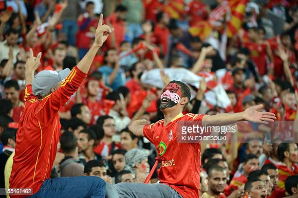 Egypt's AlAhly fans cheer before their football match against Tunisian team Esperance de Tunis during their CAF Confederation Cup final first leg in...
