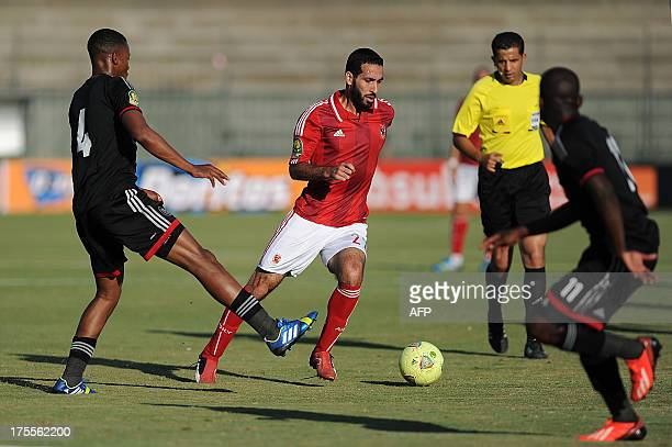 Egypt's AlAhly football club forward Mohamed Aboutrika dribbles past South Africa's Orlando Pirates defender Happy Jele during their CAF Champions...