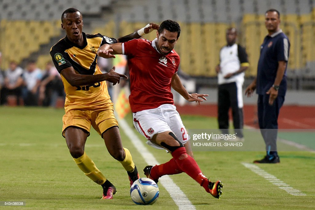 Egypt's Al-Ahly player Ahmed Fathi (R) vies with Ivory Coast's Asec Mimosas player Krahire Yannick Zakri during their CAF Champions League group B stage football match at the Borg el-Arab Stadium in Alexandria on June 28, 2016. / AFP / MOHAMED