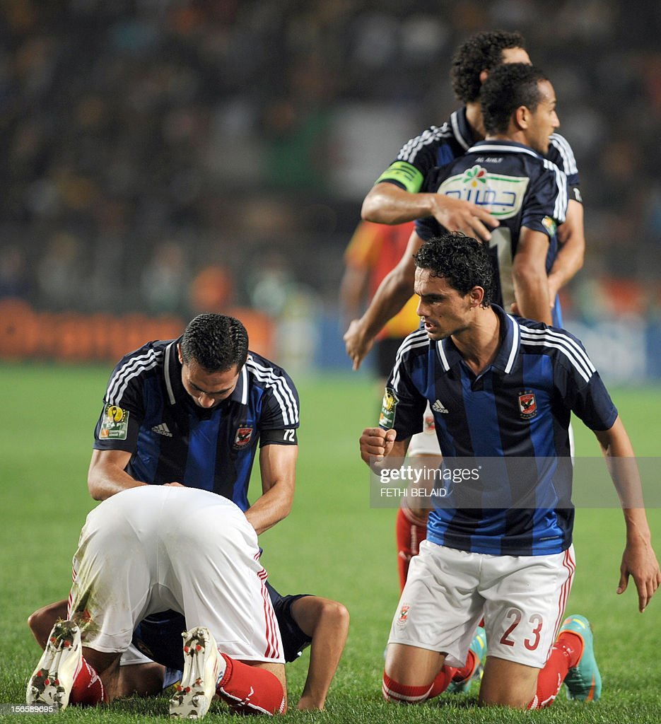 Egypt's al-Ahly players pray after team mate, forward Nagi Ismail (bottom L), scores a goal against Esperance de Tunis during their CAF Confederation Cup football match at Rades Olympic stadium near Tunis, on November 17, 2012.