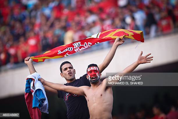 Egypt's AlAhly supporters cheer for their team before the second leg of their CAF Confederation Cup final football match against Ivory Coast's Sewe...