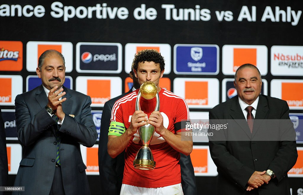 Egypt's al-Ahly team captain Hossem el Sayed (C) poses with the trophy after winning 2-1 against Esperance de Tunis in their CAF Confederation Cup football final at Rades Olympic stadium near Tunis, on November 17, 2012.