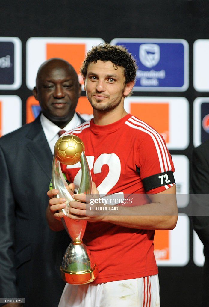Egypt's al-Ahly team captain Hossem el-Sayed poses with the trophy after winning 2-1 against Esperance de Tunis in their CAF Confederation Cup football final at Rades Olympic stadium near Tunis, on November 17, 2012.