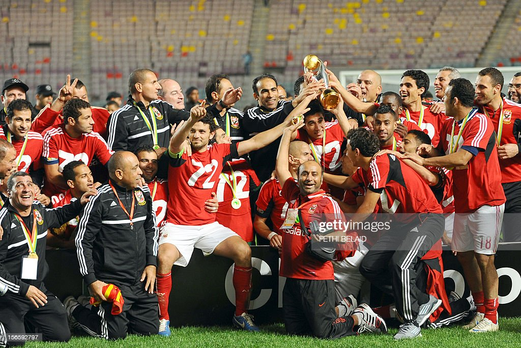Egypt's al-Ahly team pose with the trophy after winning 2-1 against Esperance de Tunis in their CAF Confederation Cup football final at Rades Olympic stadium near Tunis, on November 17, 2012.