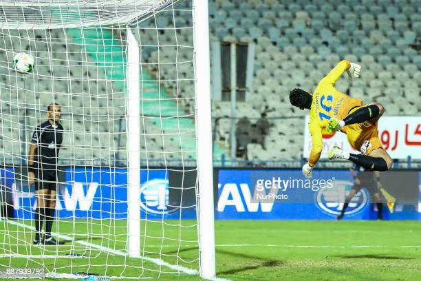 Egypt's AlAssuite sport GK Essam tharwat reacts after attempting to save the ball during the Egypt Primer League Fixtures 9 match between AlAhly and...