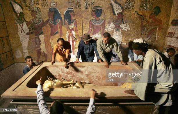 Egypt's antiquities chief Zahi Hawass supervises the removal of King Tutankhamun from his stone sarcophagus in his underground tomb in the famed...
