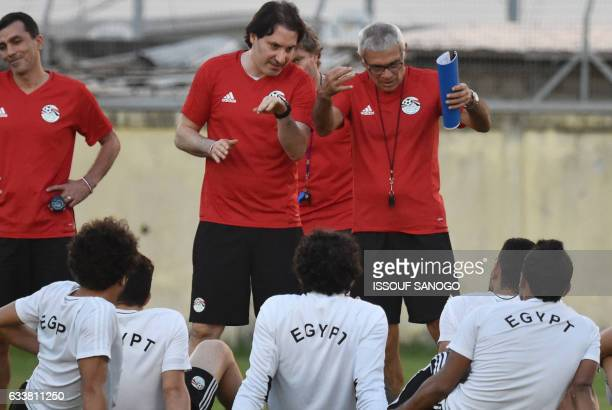Egypt's Argentinian coach Hector Raul Cuper addresses players during a training session on February 4 2017 in Libreville on the eve of the 2017...
