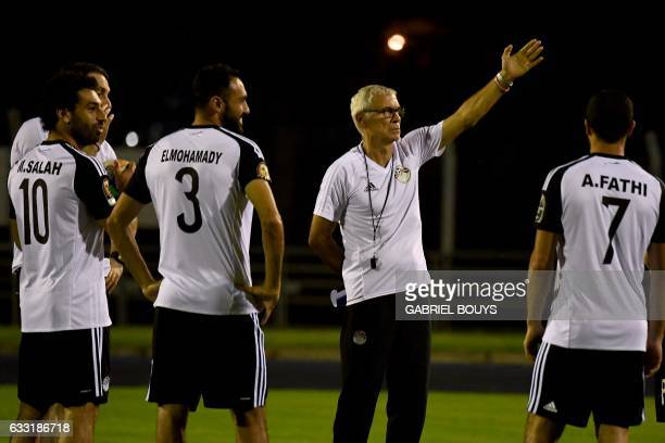 Egypt's Argentinian coach Hector Raul Cuper speaks to his players during a training session in Libreville on January 31 2017 on the eve of their...