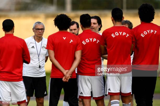 Egypt's Argentinian coach Hector Raul Cuper speaks to his players during a training session in Libreville on February 3 two days ahead of the final...