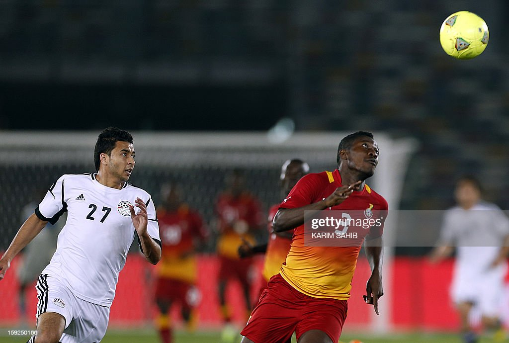 Egypt's Basem Ali (L) fights for the ball against Ghana's Asamoah Gyan (R) during their friendly football match in Abu Dhabi on January 10, 2013.