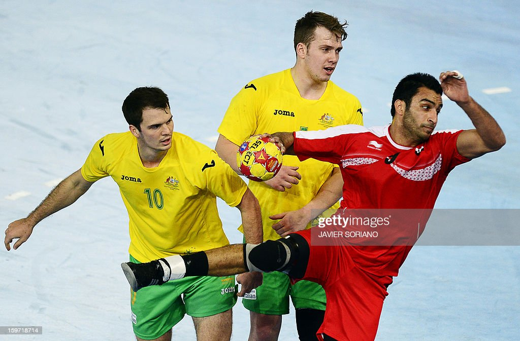 Egypt's centre back Islam Hassan (R) shoots past Australia's pivot Tommy Fletcher (C) and Australia's centre back Caleb Gahan during the 23rd Men's Handball World Championships preliminary round Group D match Egypt vs Australia at the Caja Magica in Madrid on January 19, 2013.