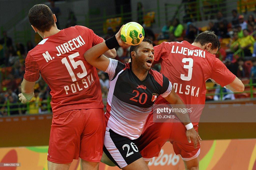 Egypt's centre back Mohamed Hashem gets past Poland's left back Michal Jurecki and Poland's right back Krzysztof Lijewski during the men's...