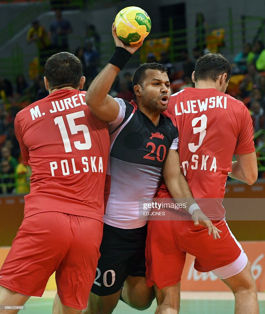 Egypt's centre back Mohamed Hashem trys to get past Poland's left back Michal Jurecki and Poland's right back Krzysztof Lijewski during the men's...