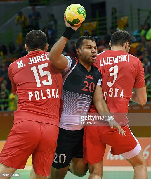 Egypt's centre back Mohamed Hashem trys to get past Poland's left back Michal Jurecki and Poland's right back Krzysztof Lijewski during the men's...