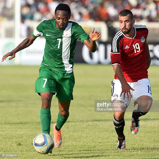 Egypt's defender Abdallah ElSaid vies with Nigeria's forward Ahmed Musa during the African Cup of Nations qualification match between Egypt and...