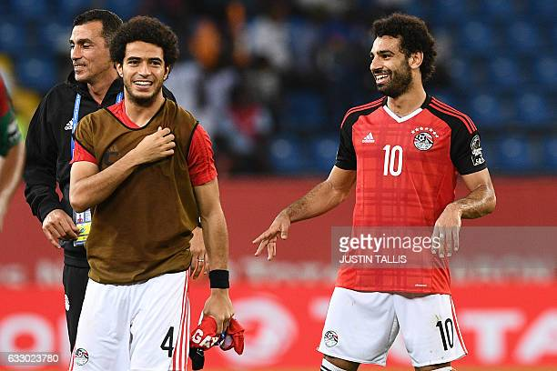 Egypt's defender Omar Gaber and Egypt's forward Mohamed Salah celebrate at the end of the 2017 Africa Cup of Nations quarterfinal football match...